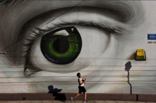 A boy walks by graffiti in Tavros, central Athens