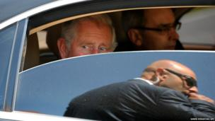 Britain's Prince Charles looks from his limo in Yerevan