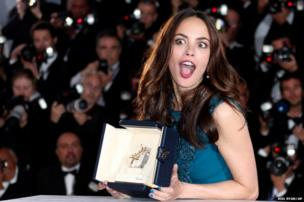 Actress Berenice Bejo poses with the Best Actress award at Cannes