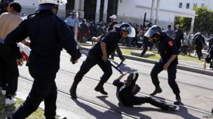 Riot police hits a protester on the ground in Rabat, Morocco - Wednesday 29 May 2013