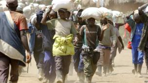 Men carrying sacks of minerals in DR Congo - Tuesday 28 May 2013