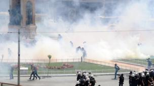 Turkish riot policemen use tear gas to disperse people protesting against the demolition of Taksim Gezi Park, in Taksim Square, Istanbul, 31 May 2013
