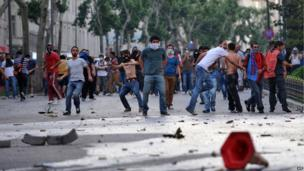 Protesters clash with Turkish riot police in the Taksim Square area of Istanbul, Turkey, 31 May 2013
