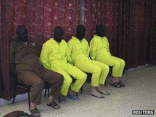 Four men accused of manufacturing chemical weapons are pictured at a news conference in Baghdad (1 June 2013)