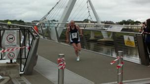 Tommy Hughes leading the marathon over the Peace Bridge with 21 miles run