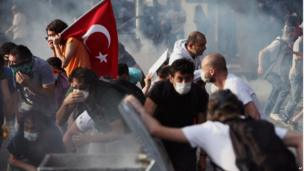 Young Turks are hit by tear gas in Ankara on 2 June.