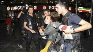 Riot police detain a female protester in Ankara, 2 June.