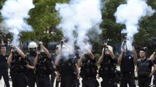 Riot police fire tear gas during a protest in central Ankara, 2 June.