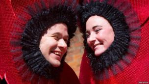 Two people dressed as poppies