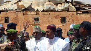Niger's President Mahamadou Issoufou visiting in front of a damaged building in Agadez, Niger - 27 May 2013