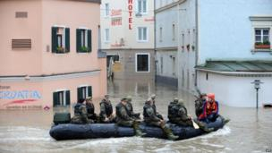 Soldiers row through flooded streets of Passau, Germany, on 4 June 2013