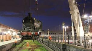 The locomotive being lifted up