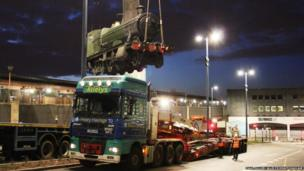 The locomotive being lifted on to a lorry
