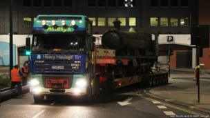 The lorry driving off with the locomotive on it