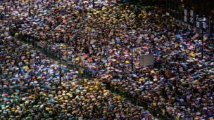 People commemorate the anniversary in Hong Kong's Victoria Park