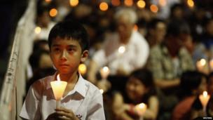 Boy participating in candlelit vigil in Hong Kong's Victoria Park