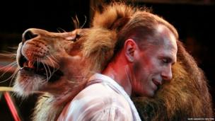 Lion tamer Oleksiy Pinko dances with a lion in a Kiev