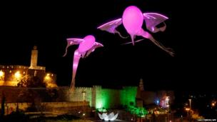 Two light installations shaped are seen during the Jerusalem Festival of Lights