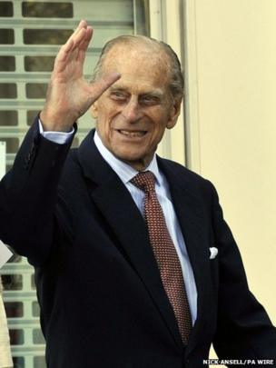 The Duke of Edinburgh waves at a visit to the SS Robin