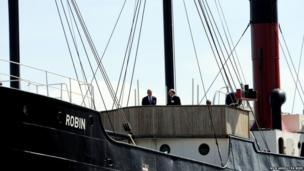 The Duke of Edinburgh (left), stands aboard the SS Robin, the world's oldest complete steamship