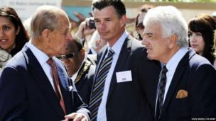 The Duke of Edinburgh talks to designer Nicky Haslam (right), whose grandfather Arthur Ponsonby designed the SS Robin