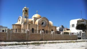 A damaged church in Qusair on 5 June 2013