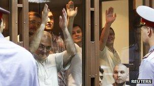 Some of the defendants inside the glass cage in court, 6 June
