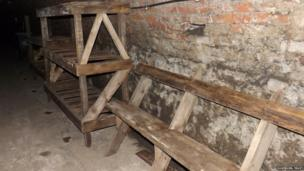 Bunk beds and benches in the Victoria Tunnel