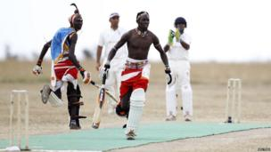 Sonyanga Olengais (C), captain of the Maasai Cricket Warriors, and his teammate Thomas Takare run between the wickets - Thursday 6 June 2013