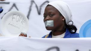 A health worker in Mozambique with tape across her mouth - Tuesday 4 June 2013