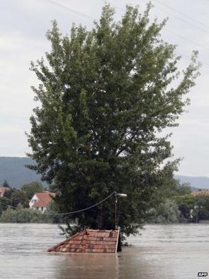 The roof of a submerged house in Kisoroszi, north of Budapest, Hungary, 7 June, 2013.