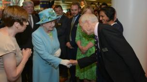 HM Queen Elizabeth II, with Fran Unsworth (L), being introduced to broadcaster John Humphrys