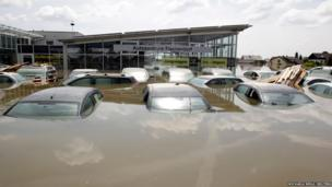 Cars at a dealership in the flooded village of Fischerdorf near Deggendorf, Germany