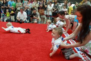 Children take part in a Baby Race to mark International Children Day in Vilnius, Lithuania