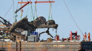 Dornier bomber wreckage being lifted on to barge