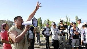 A man addresses protesters in the village of Tamga in Dzhety Oguz district 31 May 2013
