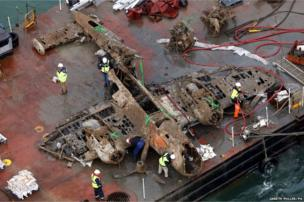 The remains of a crashed World War II Dornier bomber lays on a barge near Deal in the English Channel