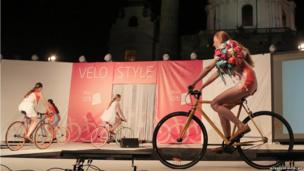 Models cycle on the catwalk