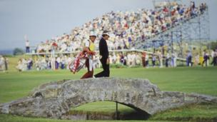 Golfer Jay Haas and his caddie crossing the Swilcan Bridge at the 1984 Open Championship in St Andrews