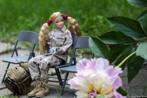 Doll on chairs