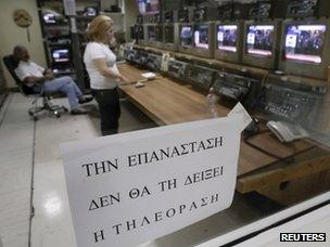 """A poster inside ERT saying: """"The revolution will not be televised"""""""