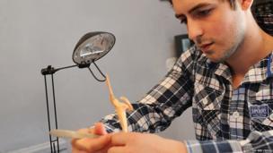 Marcus Crocker making the Freddie Mercury figurine