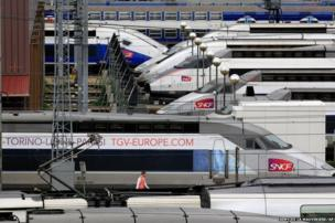 TGV high speed trains are parked near Gare de Lyon station in Paris, Thursday June 13, as French rail workers strike to protest a reorganisation of the national rail and train companies