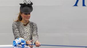 Duchess of Cambridge cutting ribbon to release champagne bottle