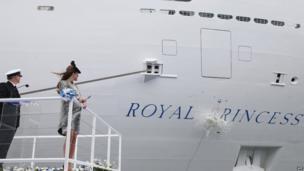 Champagne bottle smashing against Royal Princess's hull