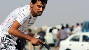 A Libyan protester in Benghazi holding a gun - Saturday 8 June 2013