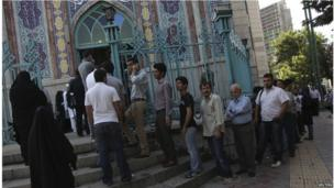 Iranians stand in line to vote at a mosque during the Iranian presidential election in Tehran June 14