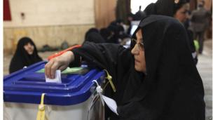 An Iranian woman casts her ballot in the presidential election at a polling station in Tehran, June 14.