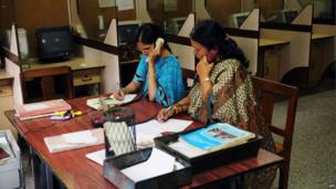 Employees at the phonogram section transcribe voice messages from customers, which will then be sent to the the receiving party as a telegram, at a telecommunications office in Bangalore