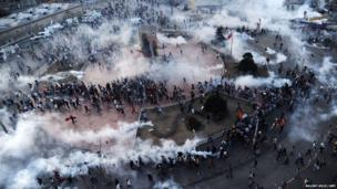 Protesters scatter as Turkish riot policemen fire tear gas on Taksim square